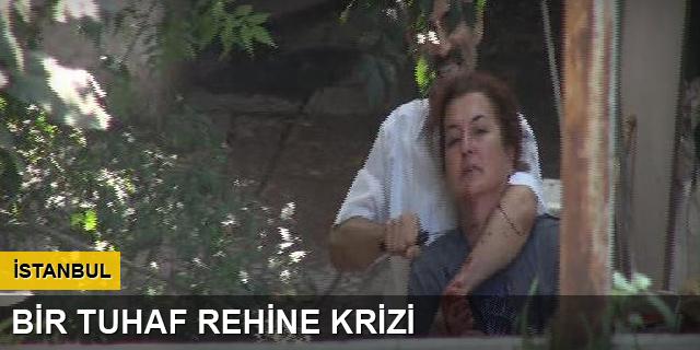 Köpek gömen kadını rehin aldı